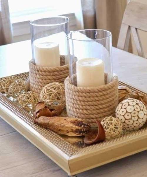 Tischdekoration mit Kerzengläsern und Schiffstau