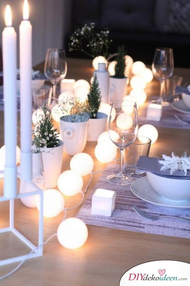 DIY table decor ideas for christmas, luminous snow balls, light chain from table tennis balls