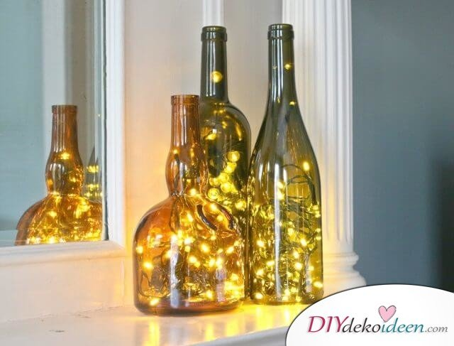 DIY Weihnachtsdeko Bastelideen mit Weinflaschen, Lichterketten in Weinflaschen, Leuchtende Weinflaschen