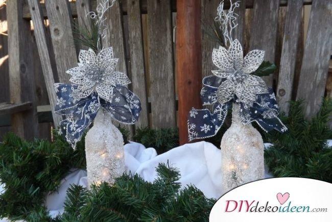 DIY Weihnachtsdeko Bastelideen mit Weinflaschen, frostige Vase mit Lichterketten, Gartendeko-Winter