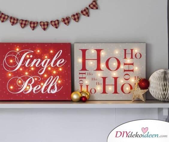 Weihnachtsdeko Ideen mit Lichterketten-leuchtendes Leinwandbild mit weihnachtlichen Sprüchen