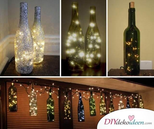 DIY Weihnachtsdeko Bastelideen mit Weinflaschen, Lichterkette-Deko, Girlande aus Glasflaschen basteln