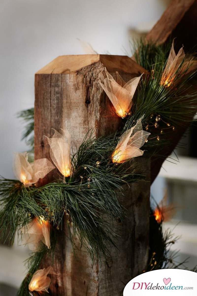 Weihnachtsdeko Ideen mit Lichterketten-Treppen schmücken