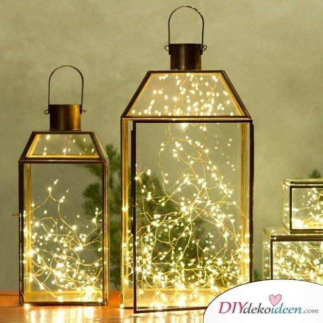 Weihnachtsdeko Ideen mit Lichterketten-Glaslaternen dekorieren