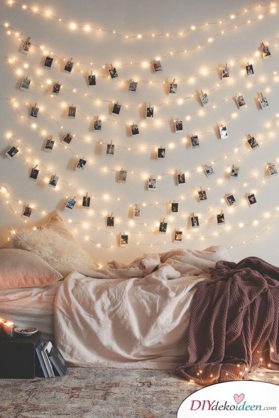 romantische Deko zum Valentinstag mit Lichterketten und Fotos