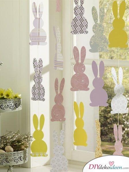 25+ DIY Deko Ideen zu Ostern, Häschen-Girlande aus Dekopapier selber machen, Fensterdeko
