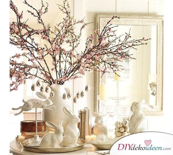 25+ DIY Deko Ideen zu Ostern, moderne Frühlingsdeko mit Mandelblüten und weißen Gipshasen