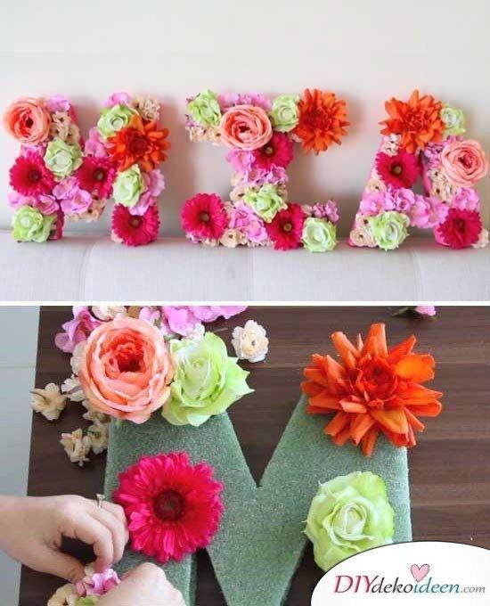 Selbstgemachte Weihnachtsgeschenk- Namen mit Blumen dekorieren