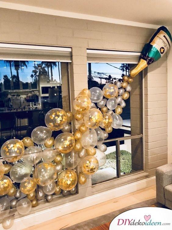 Sprudelnde Champagnerflasche – JGA Deko