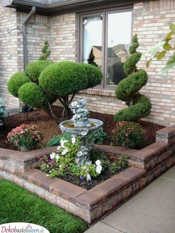 Vorgarten gestalten mit geschnittenen Büschen