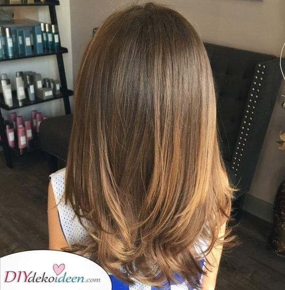 Die Haare schichten – Volumen und Definition hinzufügen